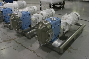 Waukesha U2 Pumps Mounted on Polished Round Tube Bases